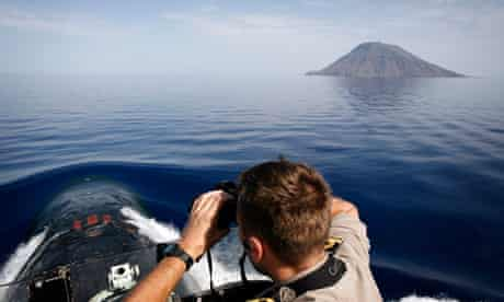 HMS Triumph, with Stromboli in the distance