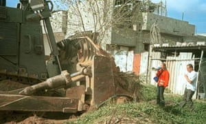 Rachel Corrie in front of an Israeli army bulldozer at Rafah, 16 March 2003