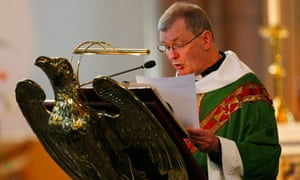 Catholic priest at a lectern