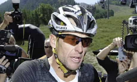 Lance Armstrong in cycle helmet and goggles