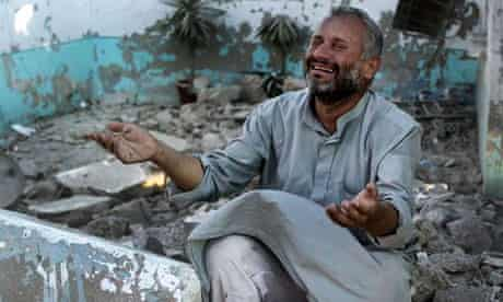 A man reacts after an airstrike on Azaz, 15 August 2012