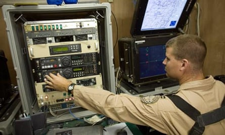 A US air force pilot controls a Predator drone from the command centre in Kandahar.