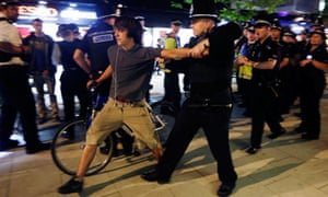 Police arrests a cyclist at Critical Mass protest