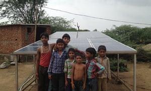Children in Khareda Lakshmipura, Rajasthan, with the Gram Power installation