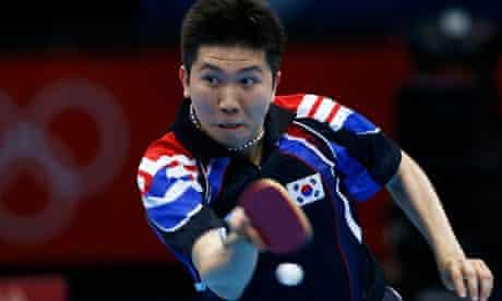 South Korea's Ryu Seungmin wielding table tennis bat
