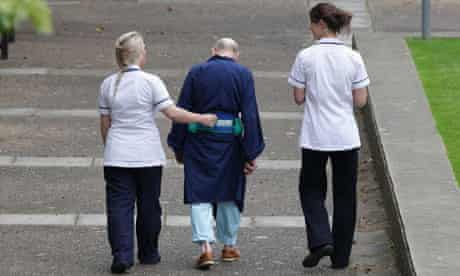 NHS staff with a patient