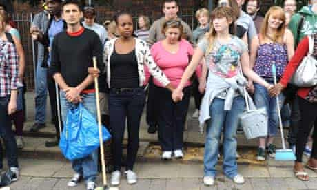 Residents prepare to help the clean-up in Clarence Road, Hackney, London, after rioting in 2011.