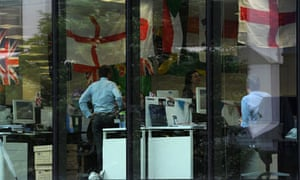 Standard Chartered bank workers in London flying the flag.