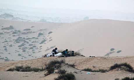 Egyptian forces take position on a sand dune during an operation in the northern Sinai peninsula.