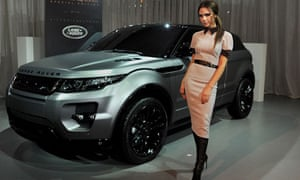 Victoria Beckham poses next to a Range Rover Evoque