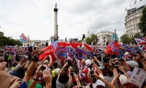 Crowds cheer as the London 2012 Victory Parade passes through Trafalgar Square