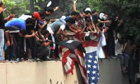 Egyptian protesters tear down the US fla