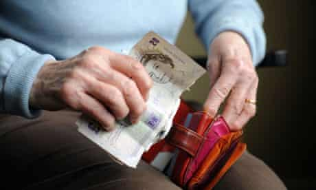 Elderly woman takes money from purse