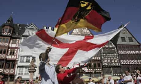 Football fans wave German and English flags in Frankfurt