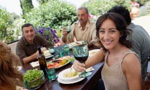 Italian Family Eating Meal in Garden
