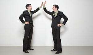 Businessmen high five each other