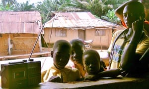 Children in the village of Oniparagba listen to Radio Wazobia, Nigeria's largest pidgin station.