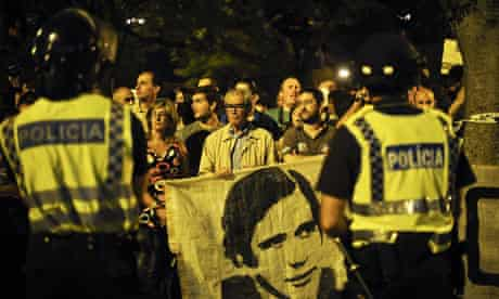 A protester holds a banner with a depiction of the Portuguese PM, Pedro Passos Coelho, in Lisbon