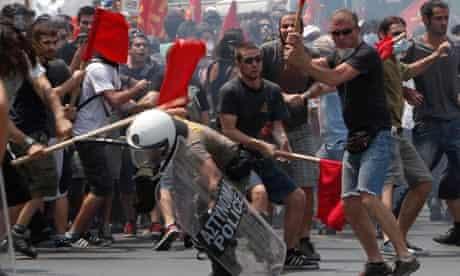 Greek rioters beat policeman