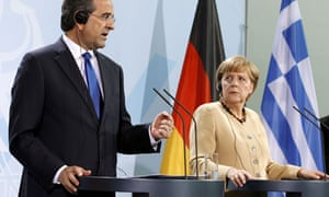 Angela Merkel and Antonis Samaras speak to the media in Berlin after discussing Greece's bailout