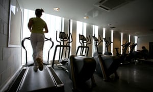 Woman runs on treadmill at gym