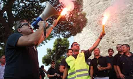 Coast guards hold flares and shout sloga