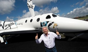 Richard Branson with a model of Virgin Galactic