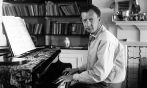 Benjamin Britten sitting at his piano, in 1950.