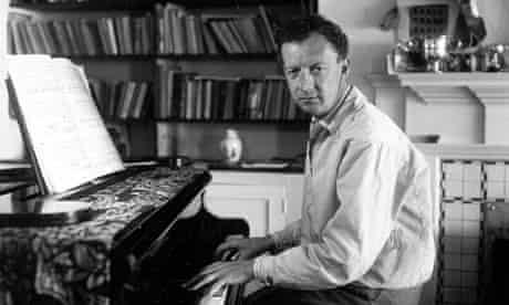 Benjamin Britten sitting at his piano, in 1950.