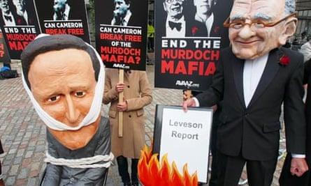 Avaaz protesters lampoon David Cameron and Rupert Murdoch, November 2012
