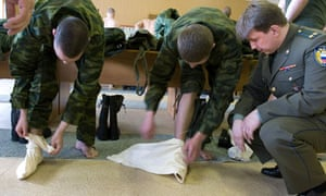 Russian soldiers in Moscow learn to put on their foot wraps, in 2007.