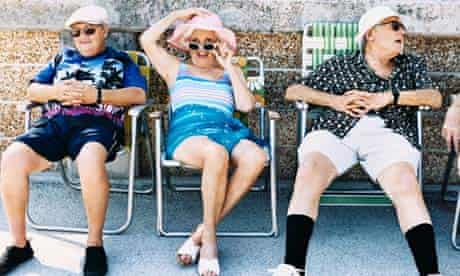 Pensioners sit on deckchairs