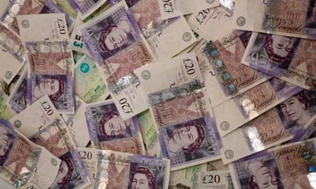 Pile of Twenty Pound and Five Pound Notes. Image shot 2007. Exact date unknown.