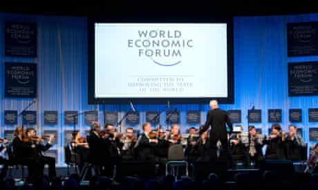 An orchestra plays at the opening ceremo