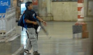 One of the gunmen pictured in Mumbai's main train station during the 2008 terror attack.