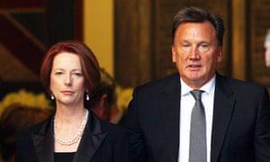 Julia Gillard with  Tim Mathieson in Sydney last year.