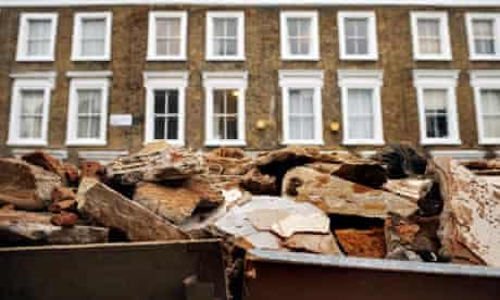 Row of houses with skip outside