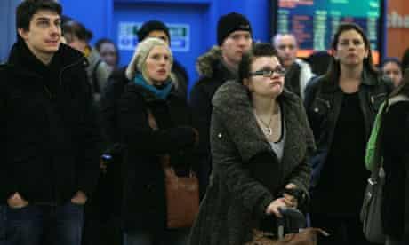 Passengers wait at an airport