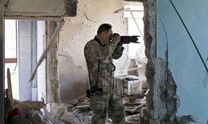Extreme tourist Toshifumi Fujimoto takes pictures in Aleppo.