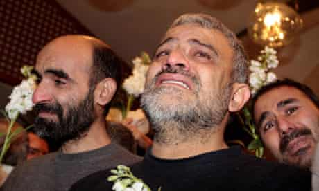 Freed Iranian men arrive at a hotel in Damascus