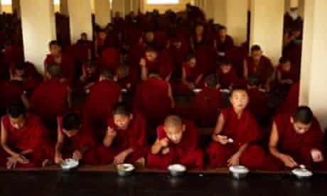 Buddhist monks having lunch