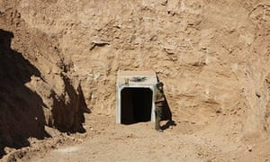 An Israeli soldier stands by the opening of a tunnel the IDF claims was built by terrorists.