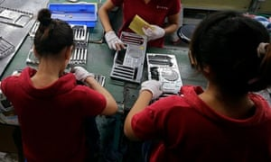 Employees work at a Foxconn factory in China