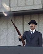 Secrets: Saddam Hussein fires shots into the air on December 31, 2000