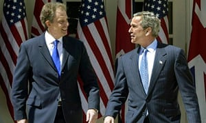Secrets: George W. Bush and Tony Blair pictured in front of American flags