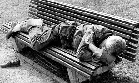 A Serbian reservist sleeps on a park bench in Belgrade in 1993.