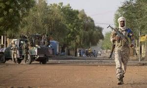 A Malian soldier walking in Gao