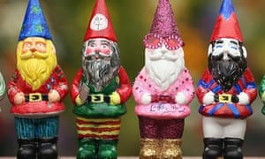 Four brightly coloured garden gnomes