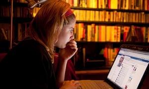 Young girl using Facebook