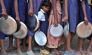 Indian schoolchildren waiting for their midday meal at a government primary school